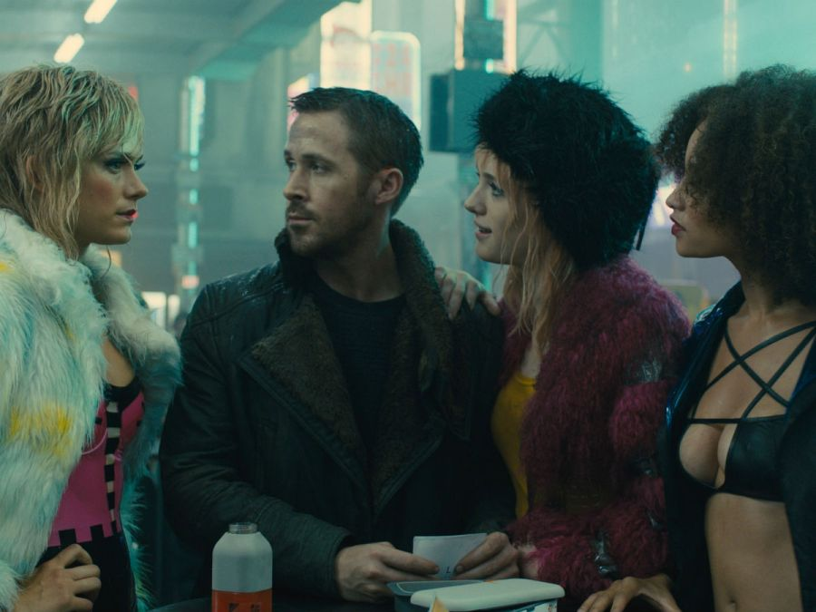 "Ryan Gosling as LAPD Officer ""K"" and Mackenzie Davis (to his right) as Mariette in Bladerunner 2049 (Image courtesy of Warner Bros. Pictures)"