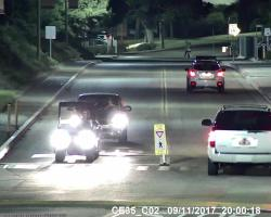 The suspect drives down College Drive followed by a green Subaru. (Courtesy of Saddleback College Police Department)