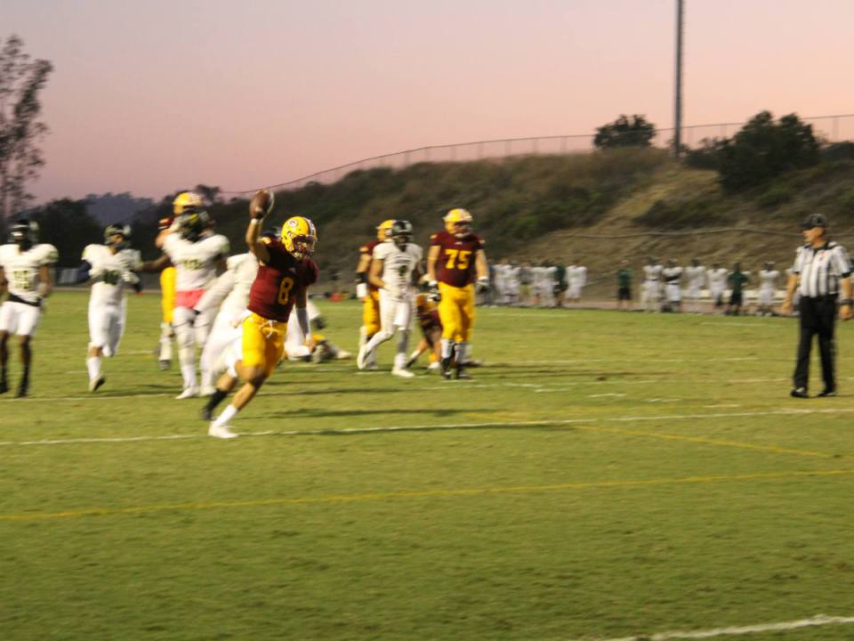 Quarterback Cam Humphrey scores a touchdown for the Gauchos on a 9-yard run. (Austin Weatherman/Lariat)