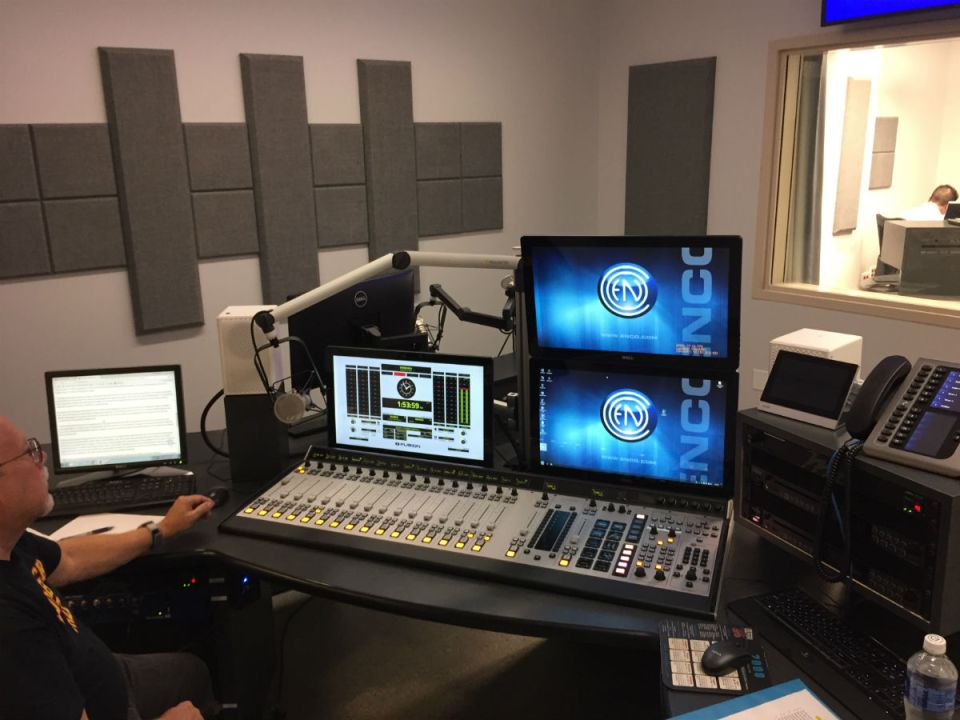 Garrison West (left) preparing for KSBR, Saddleback College's radio station (Joseph Fleming)