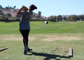 Co-captain Brooke Yafckli practicing with her driver at the Arroyo Trabuco Golf Course driving range. (Austin Weatherman/Lariat)
