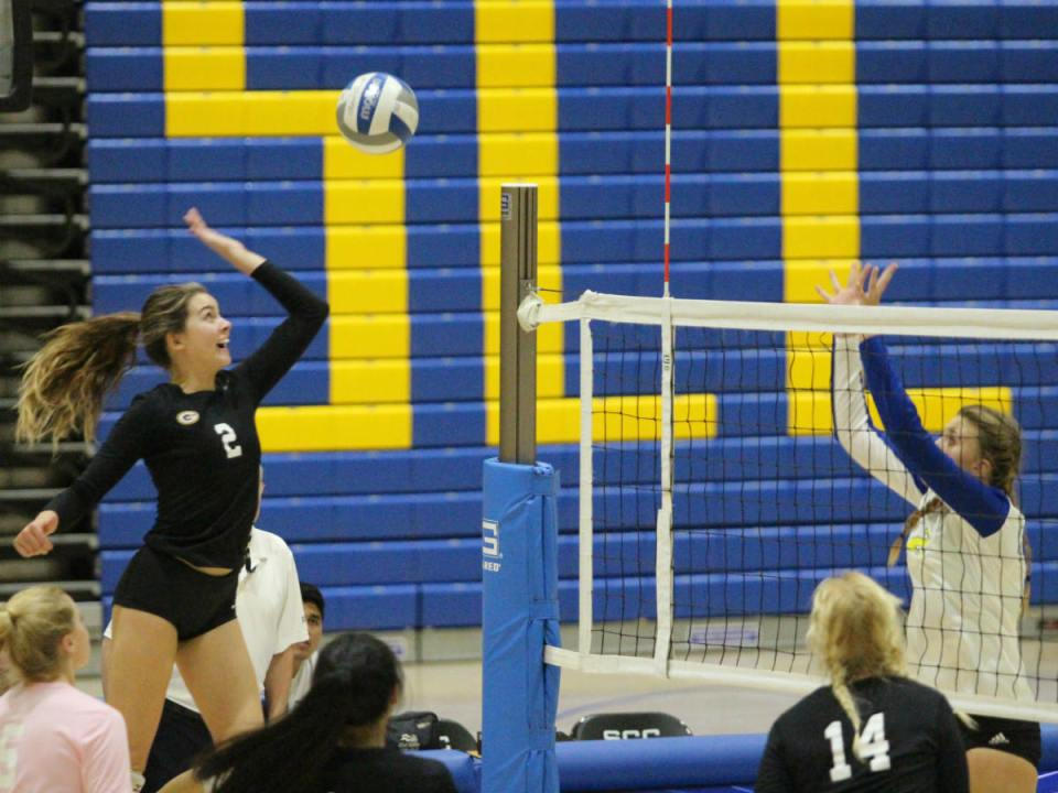 Freshman outside hitter Natalee Gray goes with her opposite hand in an attempt to save a dead ball (Colin Reef/Lariat)