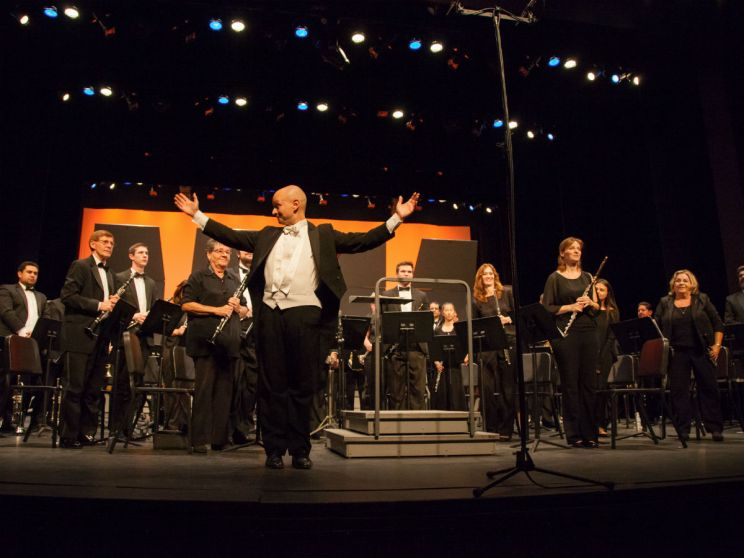 Conductor Maestro Yorgus takes his final bow after concluding the wind ensemble performance. (Ally Beckwitt/Lariat)