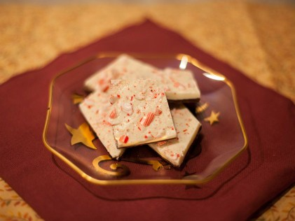 Peppermint bark made with a layer of semisweet chocolate and a layer of white chocolate, then topped with crushed candy canes. (Ally Beckwitt/Lariat)