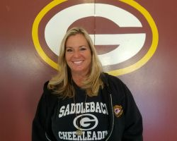 Coach Denise Harris, cheer advisor and coach collects items for the homeless with her squad.