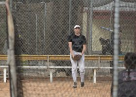 A softball player prepares her stance during practice (Daniela Sanchez/Lariat)
