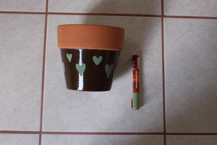 Step #2: One can decorate your flowerpot with the use of colorful acrylic paint markers.