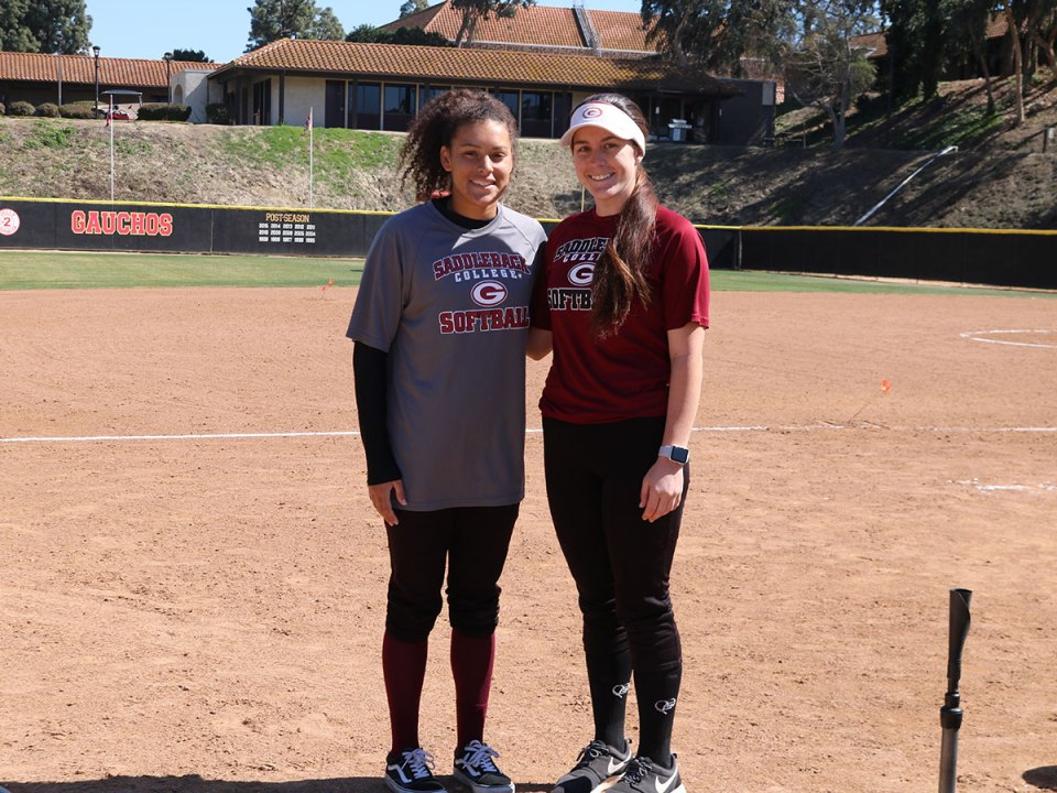 Captains Utility Haliegh Wilkerson and Haley Rose pose on the field. (Lizzie Williams/Lariat)