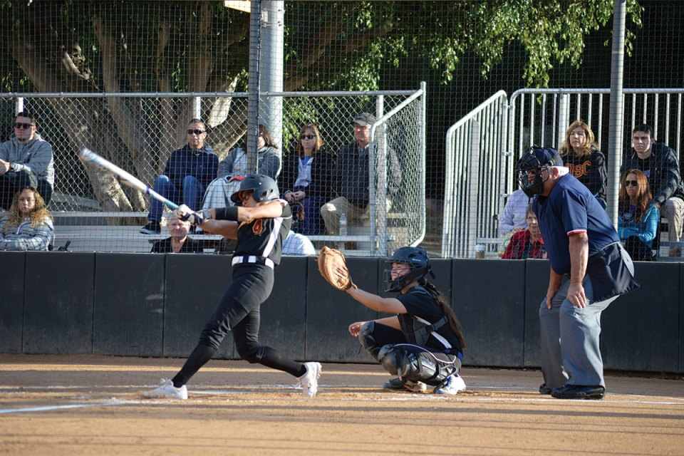 Haliegh Wikerson displaying precise batting form for a singled hit. (Andrea Clemett/ Lariat)