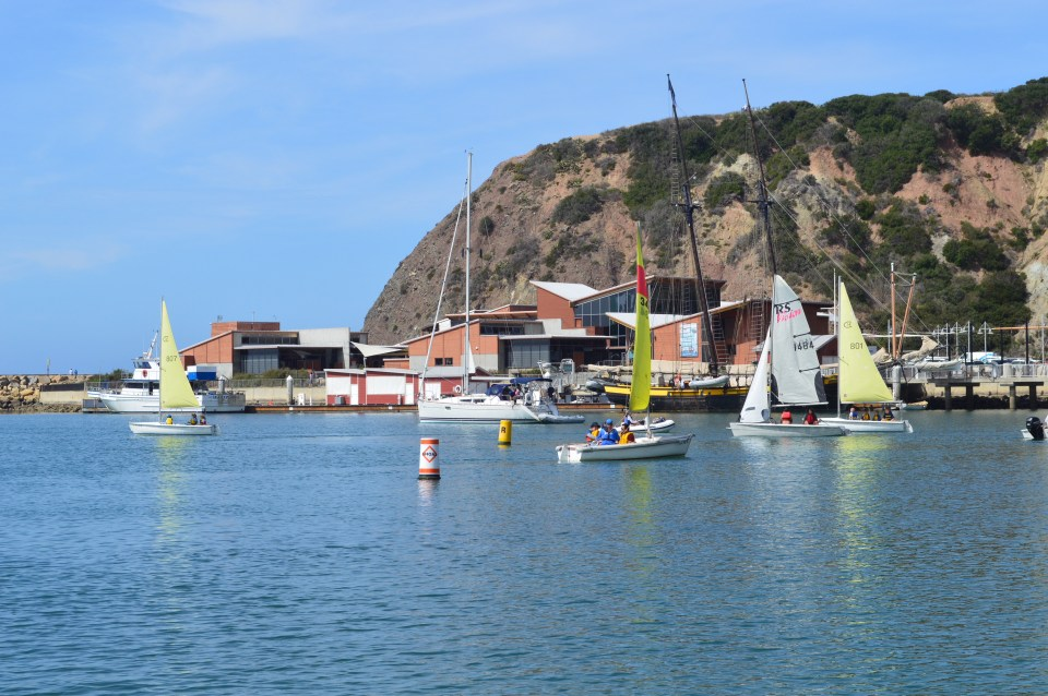 Saddleback Catalina dinghies sail into warmer weather at Baby Beach in Dana Point. (Andrea Clemett/ Lariat)