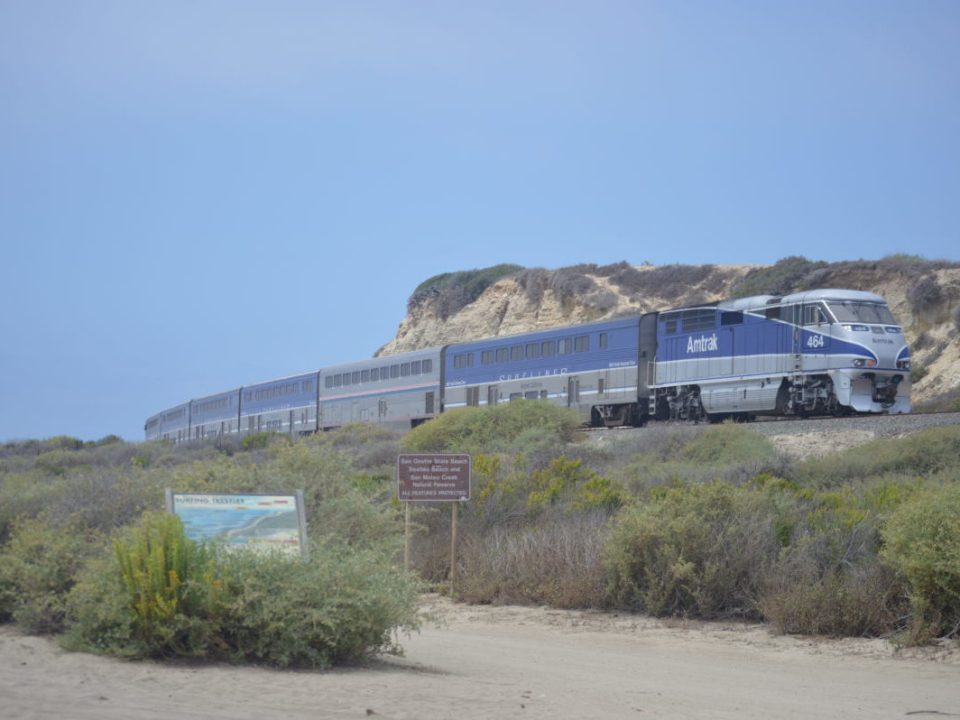 Infamous Amtrak buzzes by the cliffside giving the name Trestles to the stretch of beach. (Andrea Clemett/Lariat)