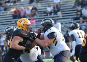 """Defensive lineman Austin Moore, left, blocks Daniel Duncan from college of the Canyons """"Sept. !."""""""