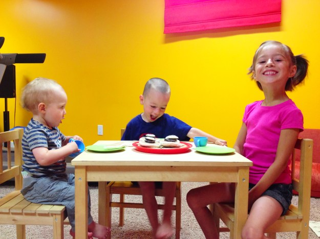 Having a tea party in the playroom.