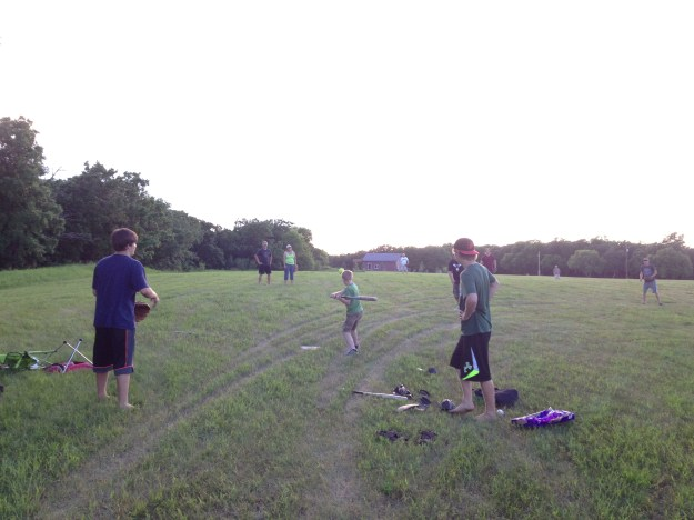 After supper, a game of baseball was started in the field.