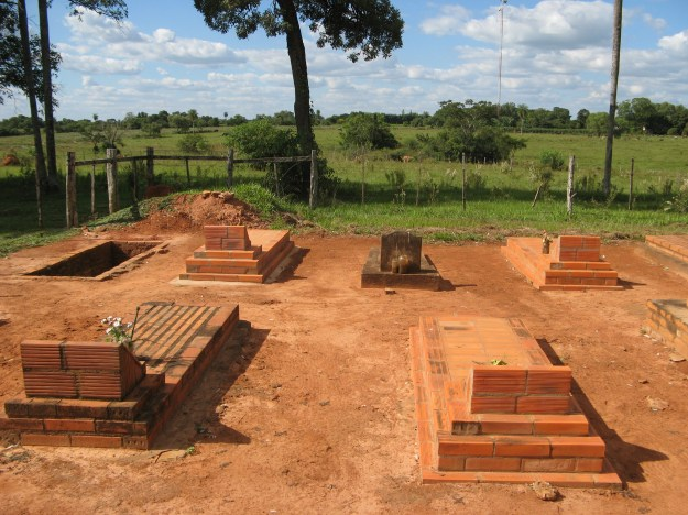 Interesting story: See the really old plot amung the newer ones? It is the grave of an adulterer or a murderer or something, and was originally outside the cemetery gates. Over time they had to expand and that is why it is now inside the gate.