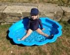 Poppy in her paddling pool