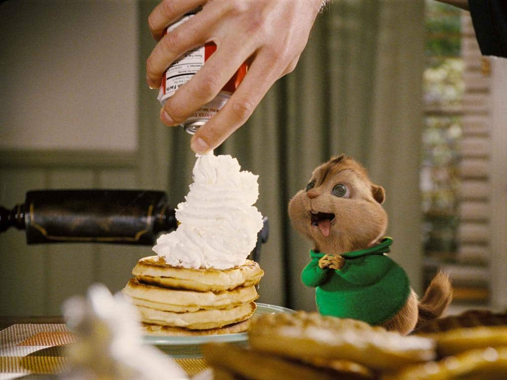 The omnivorous Theodore prepares to dive into his favorite dish Ð waffles and whipped cream.