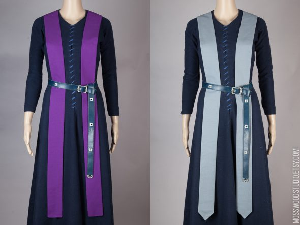 Image shows two coloured priest stoles on a mannequin side by side. One is purple and the other is grey.