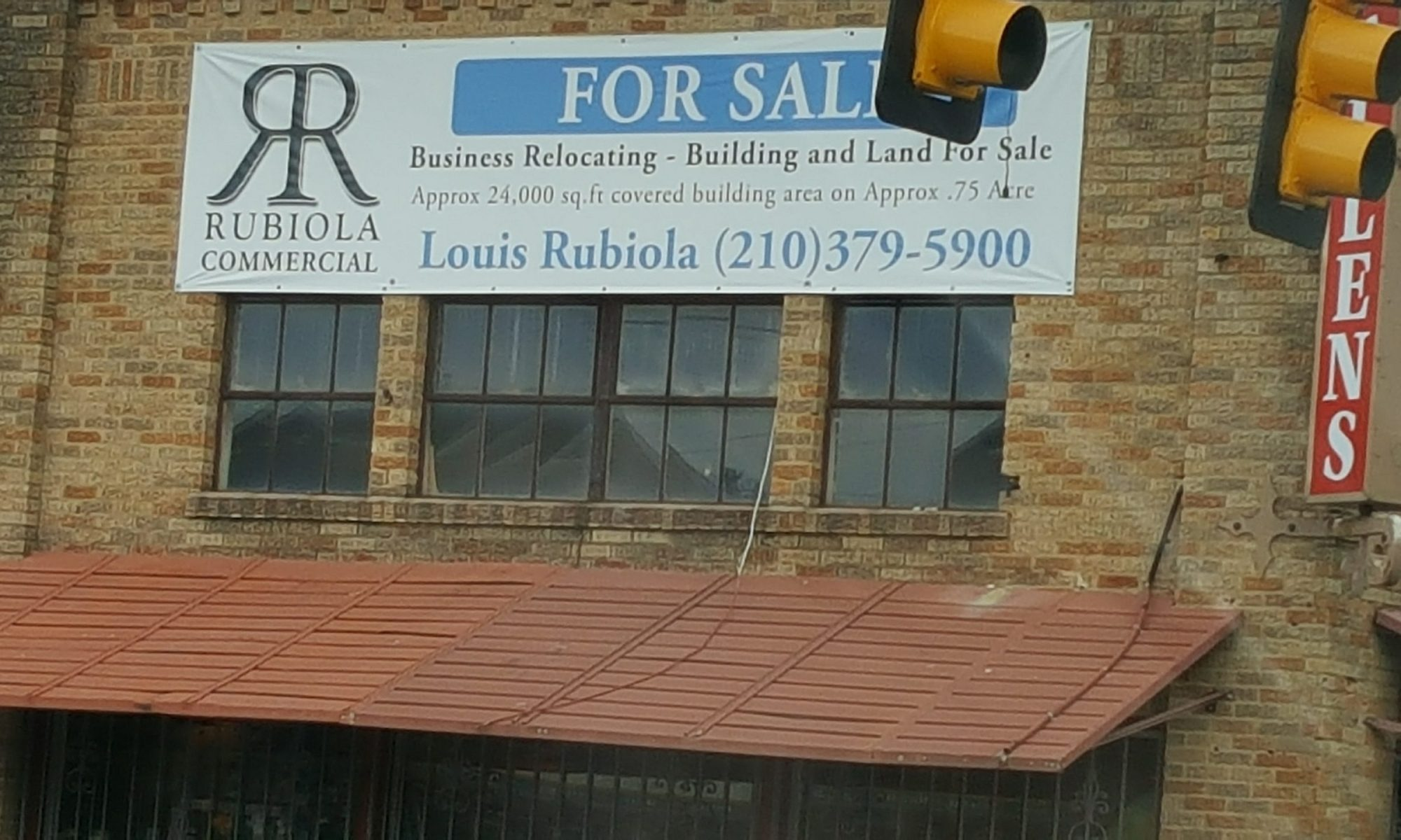 Picture of for sale sign on building