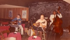 photo of Jimmy Wyble playing guitar with Dave Koonse (also on guitar), Leroy Vinnegar, bass (circa-mid-70s)