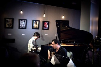 photo of Josh Nelson playing piano and Larry Koonse playing guitar