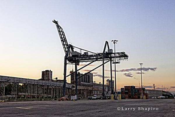 shipping dock crane at dusk