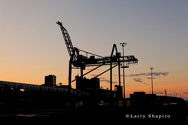 shipping dock crane at dusk