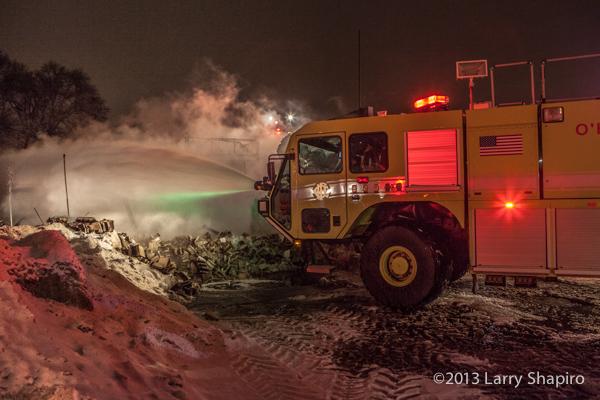Oshkosh Striker airport crash truck at fire scene