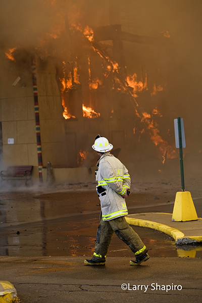 chief fire officer surveys massive fire scene