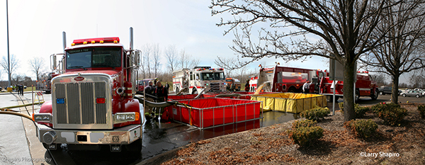portable tanks and fire engines provide water at huge fire