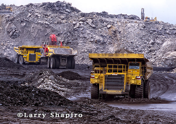 giant earth movers at coal mining operation
