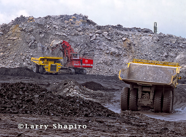 giant earth movers at a mining operation