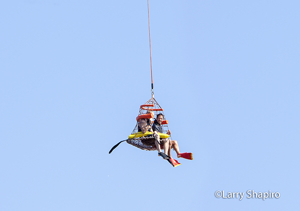 fire department divers in a rescue net
