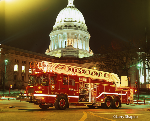 night shot of fire truck with state capital
