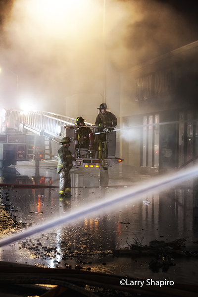 night fire scene with fire chief
