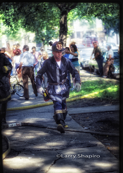 fireman waling through a crowd
