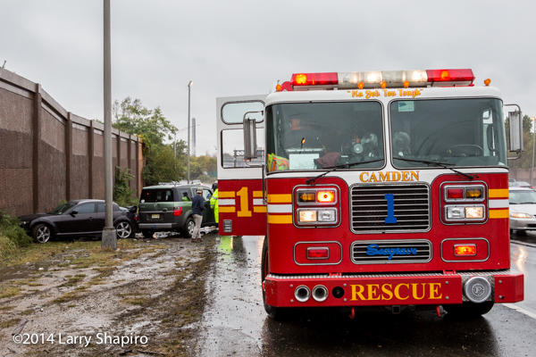 Seagrave fire truck at highway crash scene in the rain