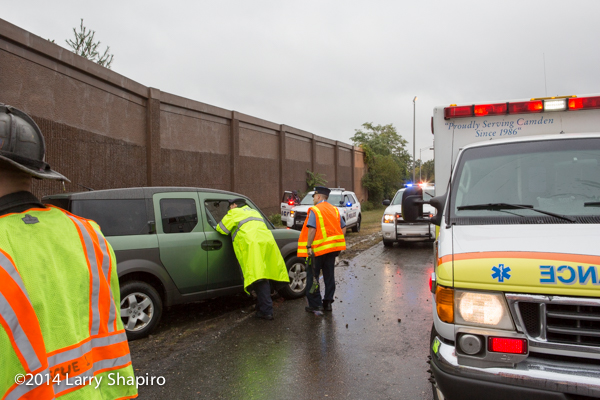 police officers at crash site on rainy day