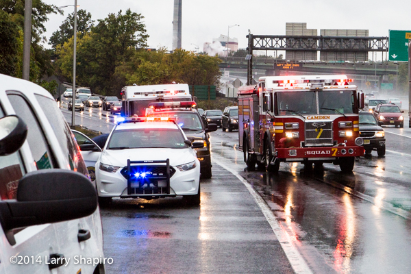 emergency units on a rainy highway at accident site