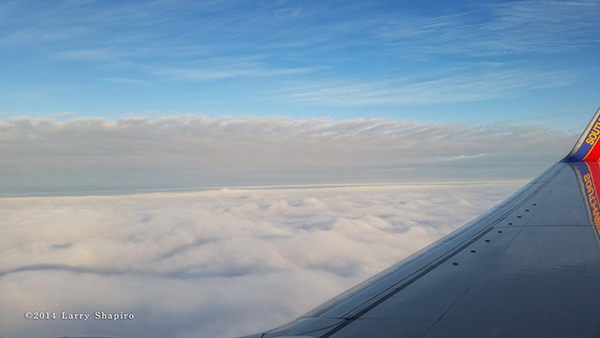 descending through the clouds in an airplane