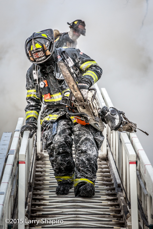 ice encrusted fireman with saw