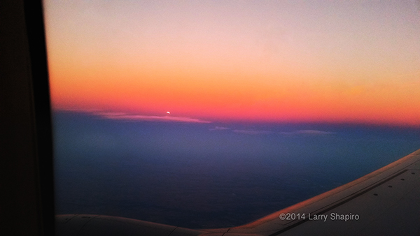dramatic sunset through an airplane window
