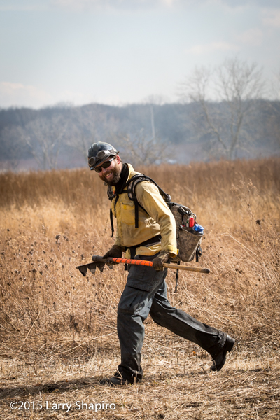 wildland firefighter with tools