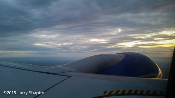 looking at the wing and engine of a Southwest Airlines Boeing 737-700 with a dramatic sky in the background