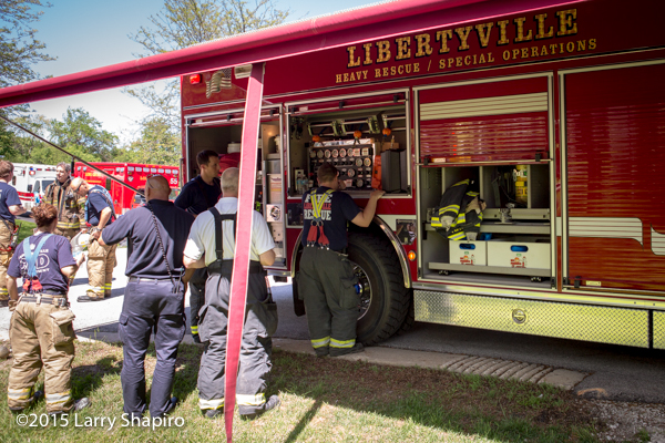 firemen at a fire scene refilling air bottles