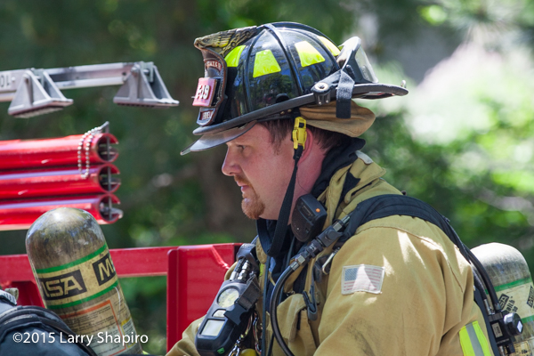 the face of a fireman at a fire scene