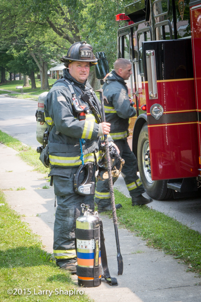 firefighter with PPE and tools