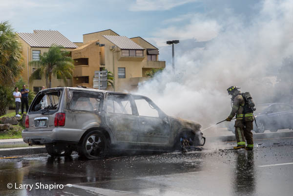 firefighter extinguishing a car fire