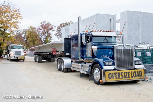 Kneedtrog tractor hauling precast concrete