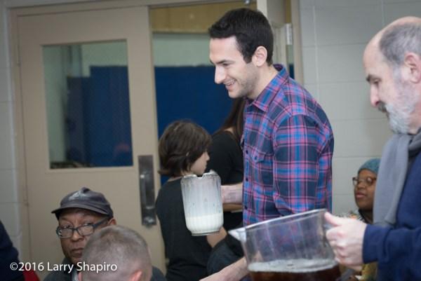 volunteer serves Thanksgiving dinner